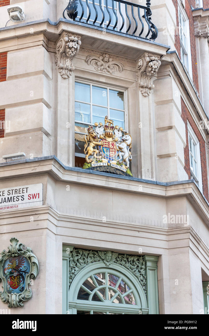 A view of the Royal Warrant for Queen Elizabeth II outside Fortnum and Mason, world famous department store in Piccadilly, London - Stock Image