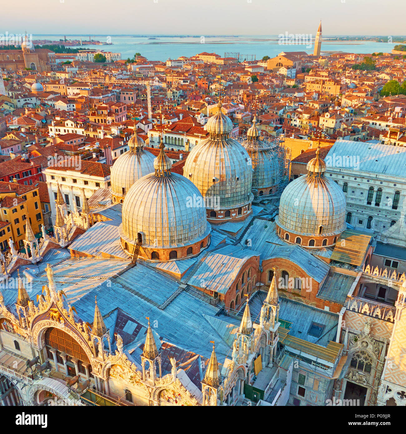 Domes of The Cathedral Basilica of Saint Mark in Venice in the evening, Italy. Wide angle shot - Stock Image