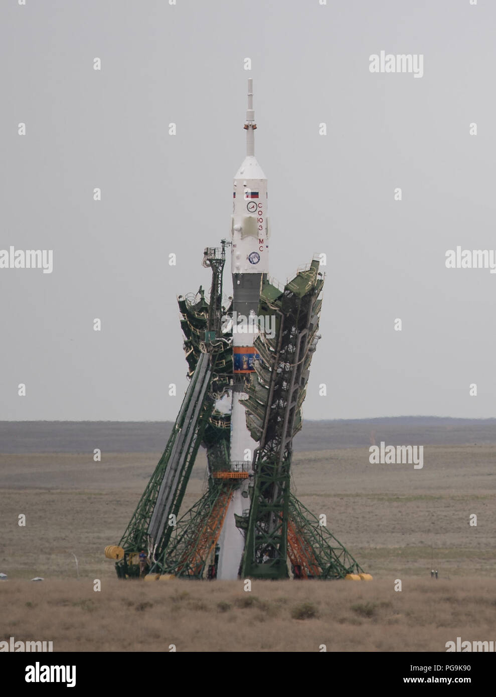 The Soyuz MS-09 rocket is seen as the gantry arms are lowered prior to launch, Wednesday, June 6, 2018 at the Baikonur Cosmodrome in Kazakhstan. Expedition 56 Soyuz Commander Sergey Prokopyev of Roscosmos, flight engineer Serena Auñón-Chancellor of NASA, and flight engineer Alexander Gerst of ESA (European Space Agency) will spend the next six months living and working aboard the International Space Station. - Stock Image