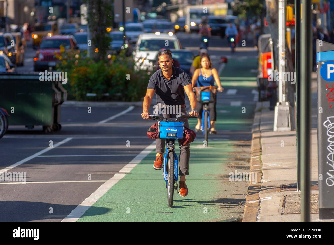 Bikers on the newly repainted Ninth Avenue bike lane in the Chelsea neighborhood of New York on Thursday, August 23, 2018 . (© Richard B. Levine) - Stock Image