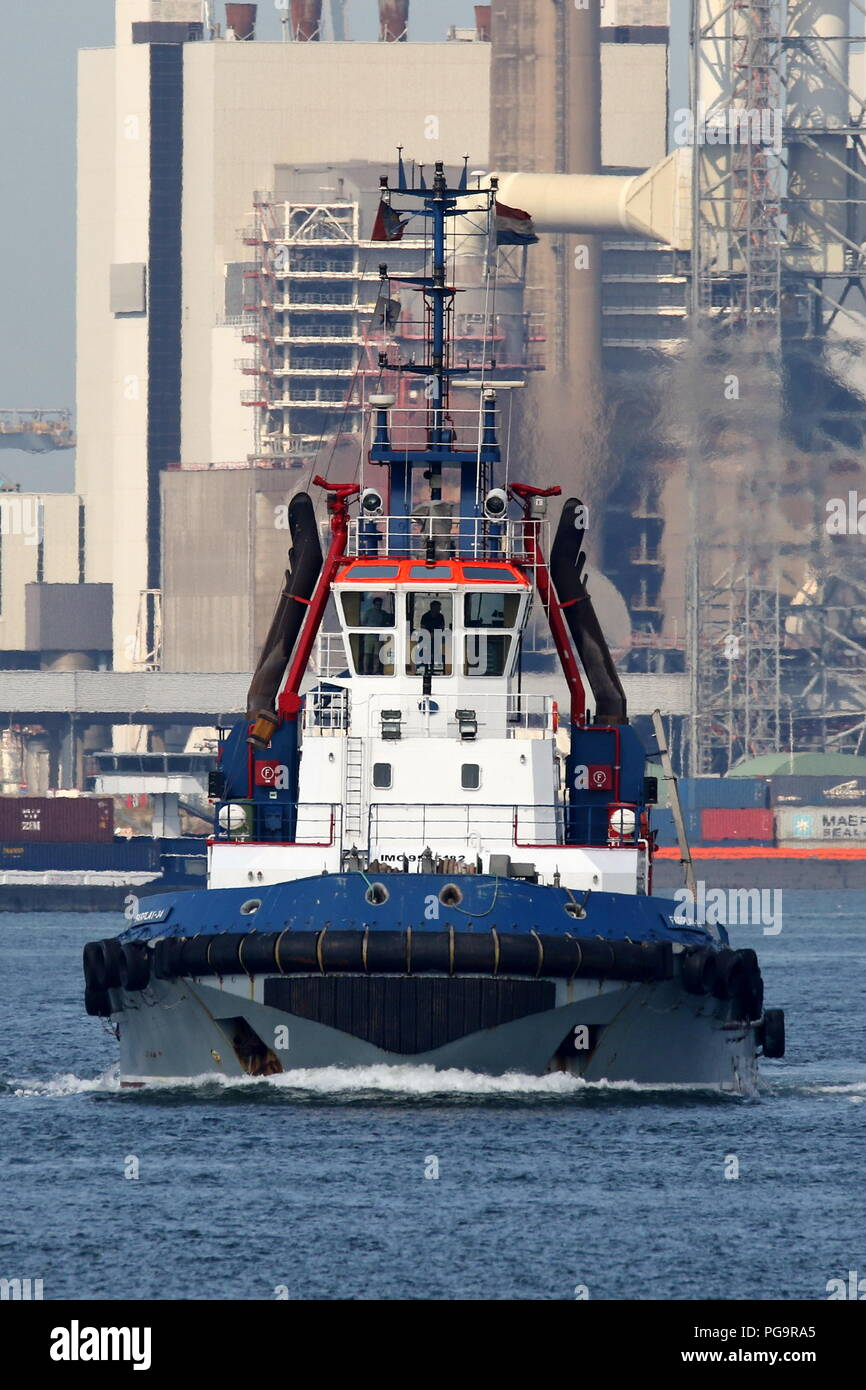 The harbor tug Fairplay-34 operates on 27 July 2018 in the port of Rotterdam. - Stock Image