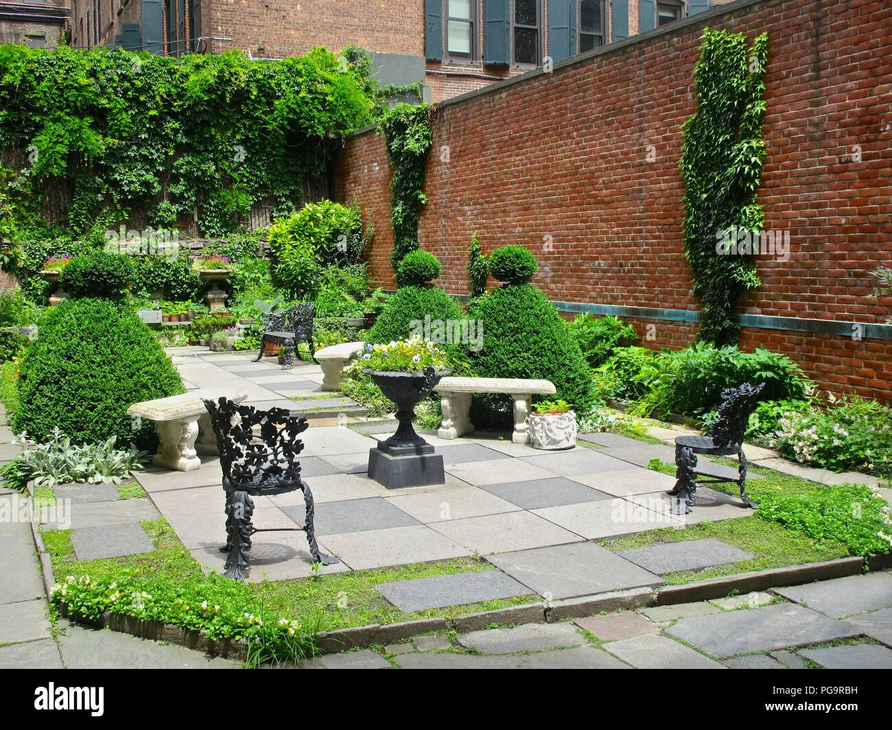 The garden behind the Old Merchant's House (1832), the only nineteenth-century family home in New York City preserved intact. - Stock Image