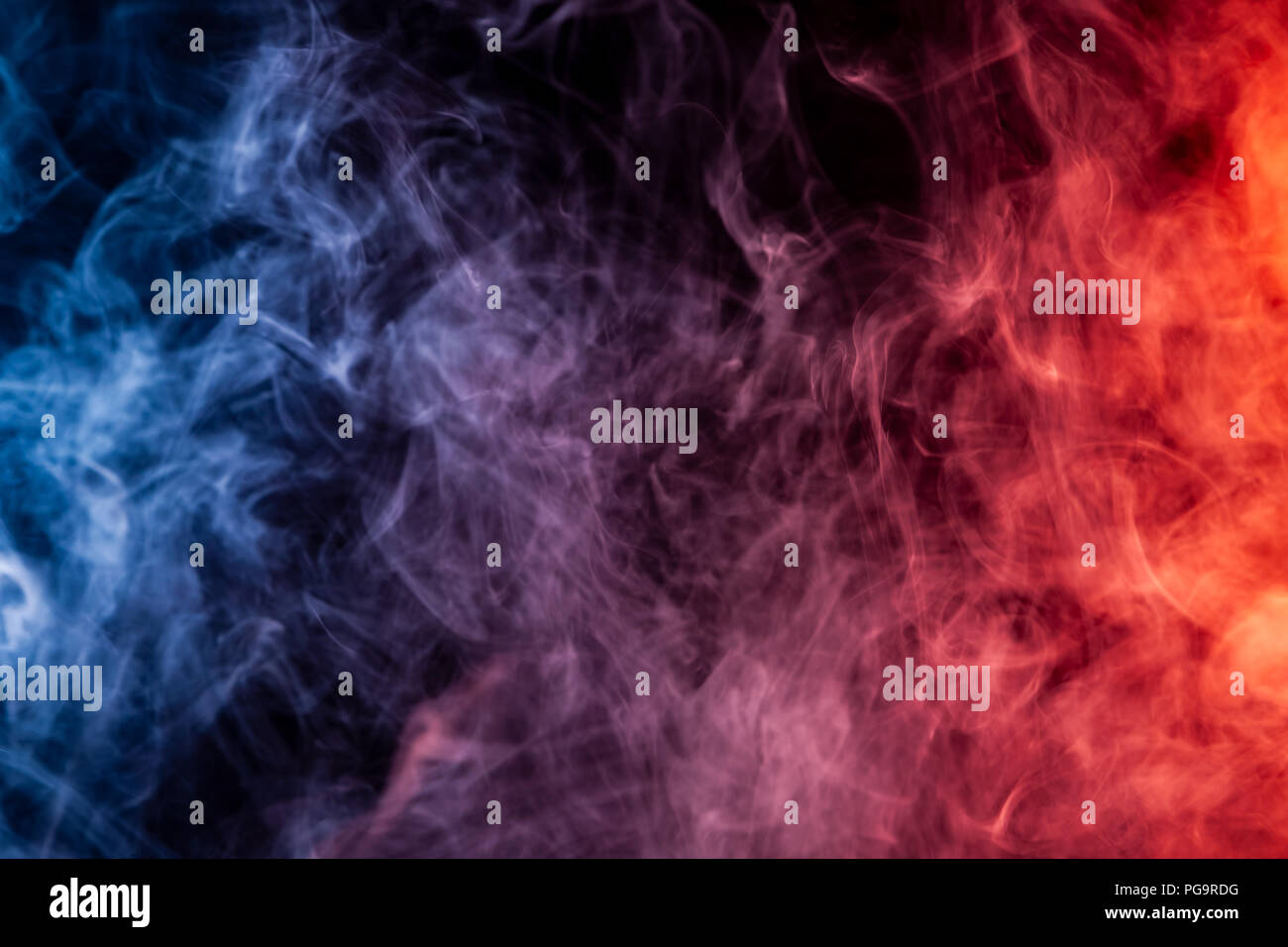 red blue and white smoke on black background stock photo alamy https www alamy com red blue and white smoke on black background image216574892 html
