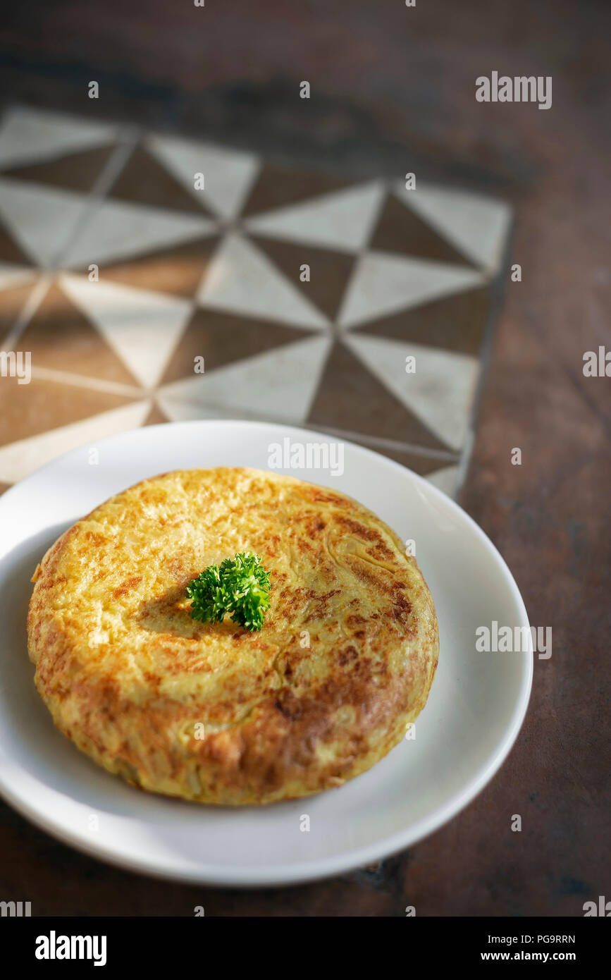 spanish tortilla omelet traditional tapas food on traditional rustic old tiles background in seville - Stock Image