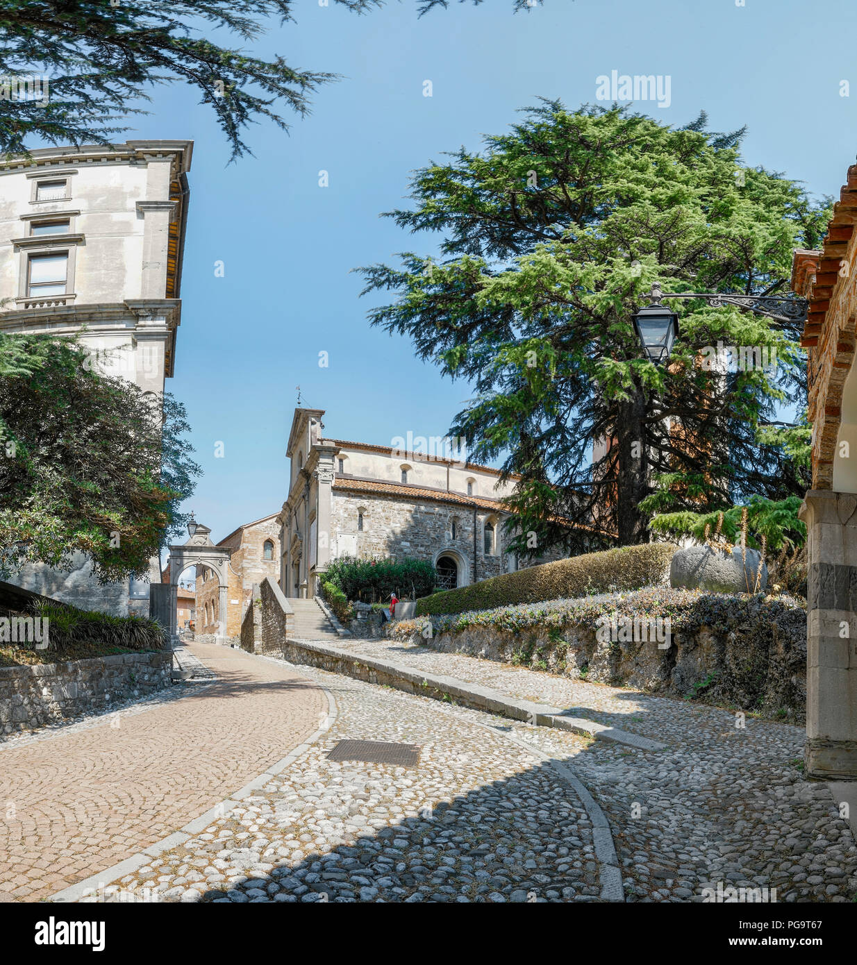 the ascent of the hill leading to the castle of Udine, Italy - Stock Image