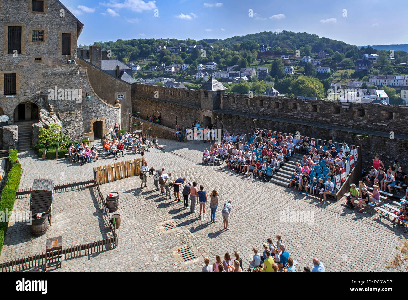 Tourists watching falconry / bird of prey show in the Château de Bouillon Castle, Luxembourg Province, Belgian Ardennes, Belgium - Stock Image