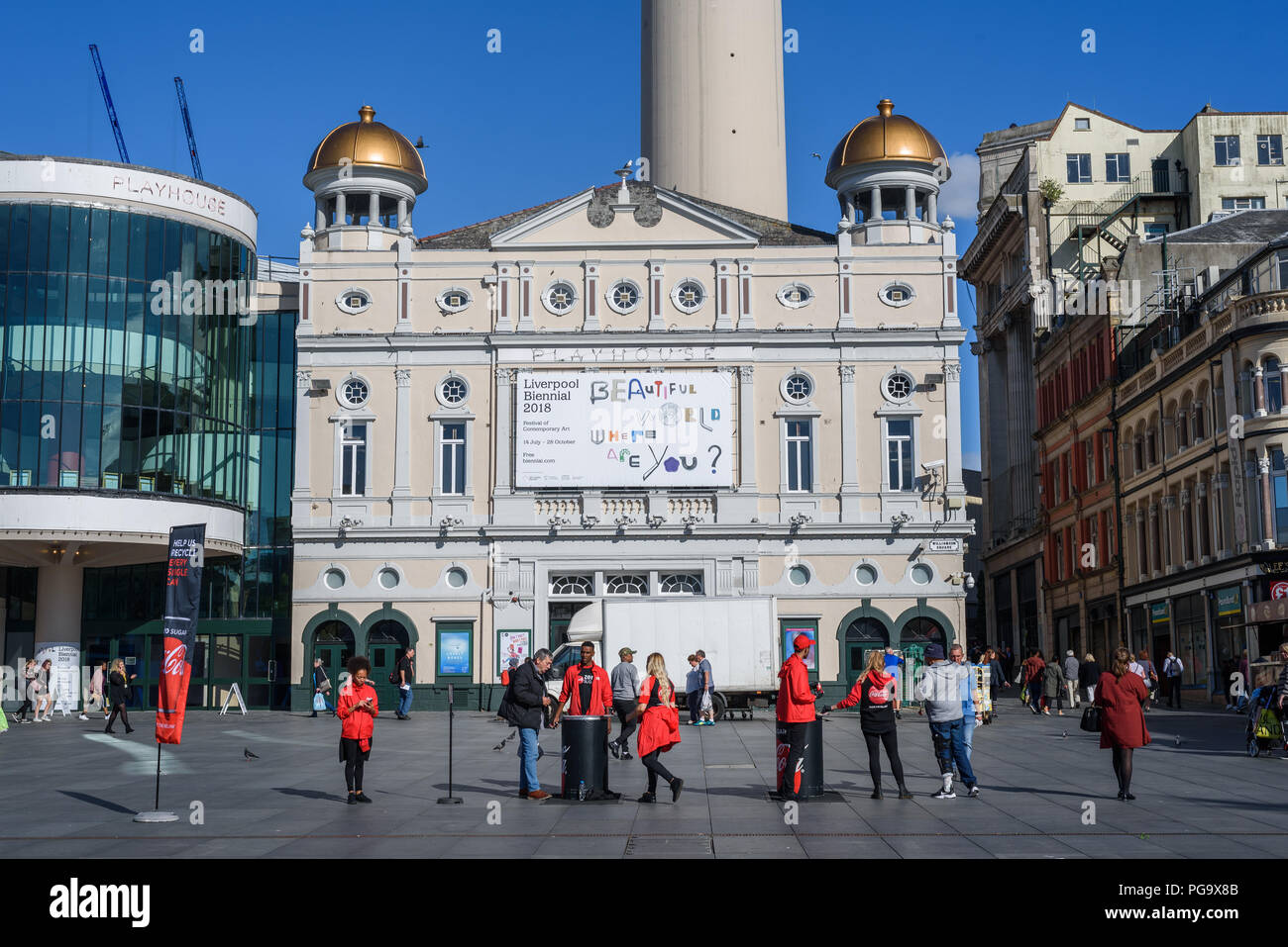 Representatives promoting Coca Cola in  Williamson Square, with the Liverpool Playhouse theatre in the background at Liverpool, Merseyside, England, U Stock Photo