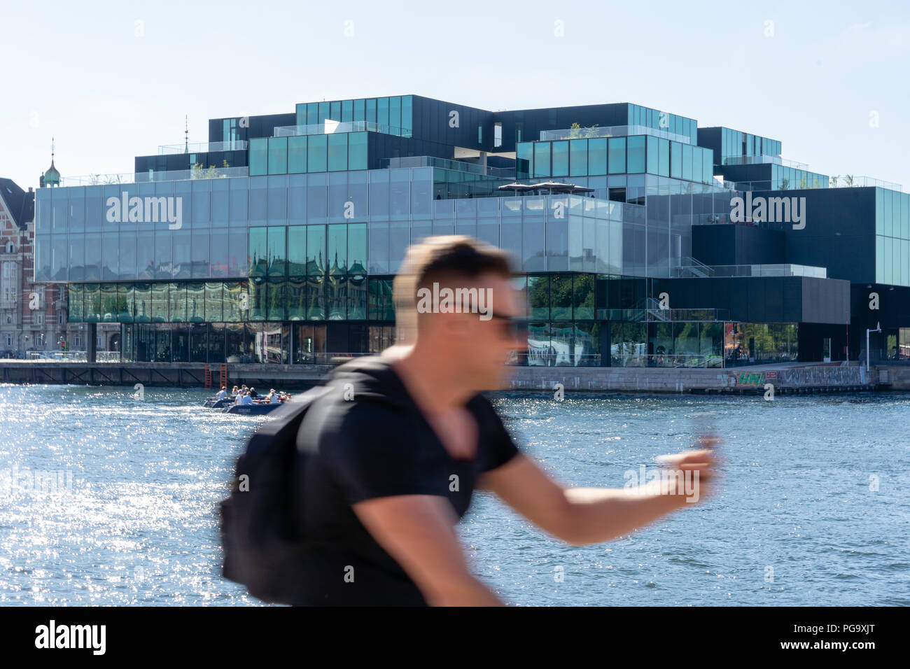The Blox building from 2018 by the Copenhagen waterfront, domicile for DAC, Dansk Arkitektur Center. Bicyclist in front. - Stock Image