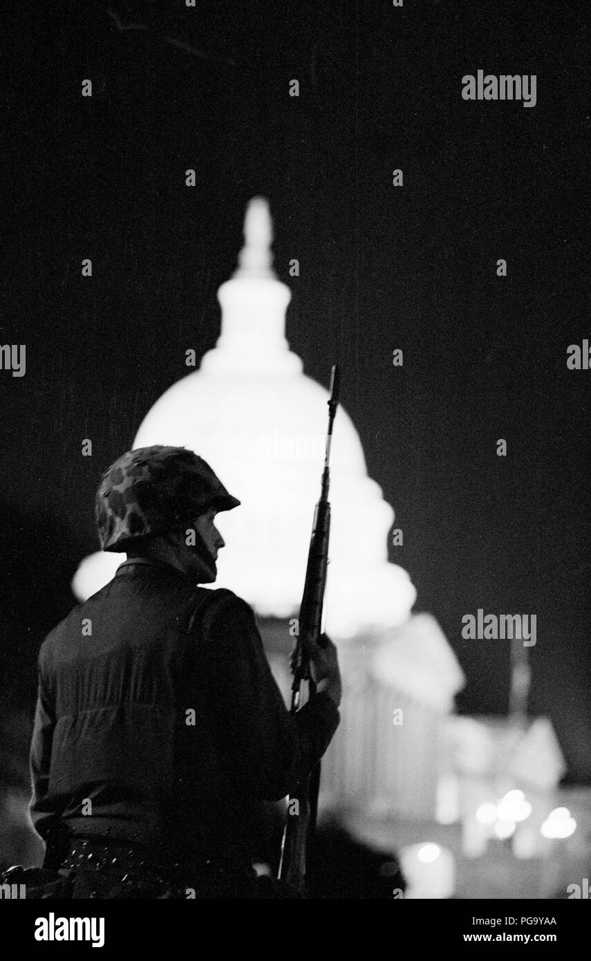A national guardsman stands watch near the US Capitol building with his rifle during the 1968 riots in Washington, DC. The Washington, D.C. riots of 1968 were 4 days of riots in Washington, D.C. that followed the assassination of civil rights activist Martin Luther King Jr. on April 4, 1968. The King assassination riots affected at least 110 U.S. cities; Washington, along with Chicago and Baltimore, were among the most affected. - Stock Image