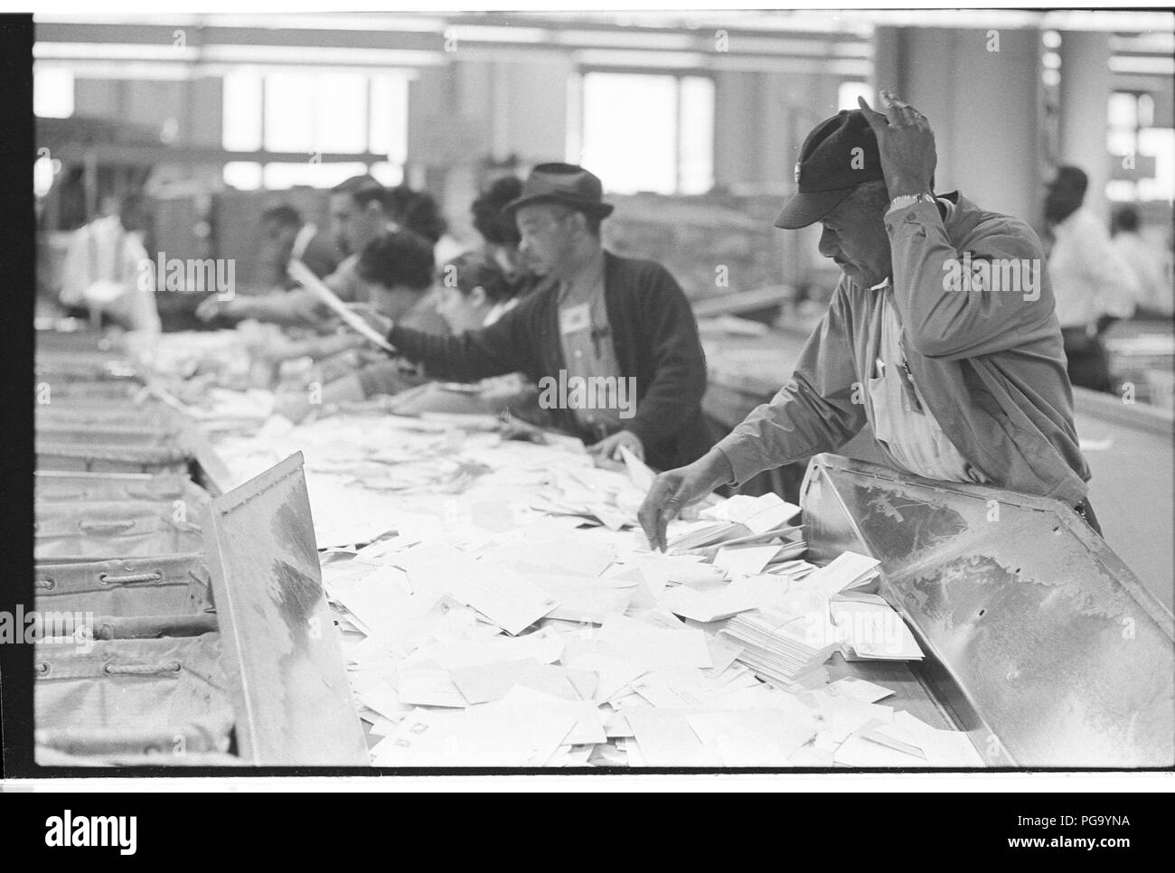 African American US Postal Service employees at work at Washington, DC post office - Stock Image