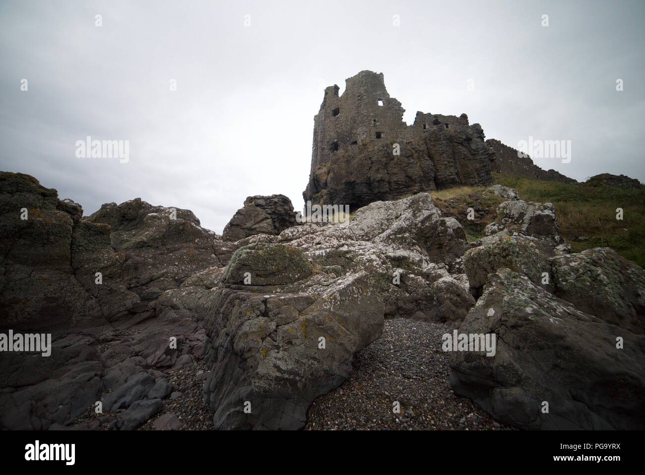The ruins of an old castle on the edge of a cliff, Dunure Castle, Carrick Coast. (13th century castle ruins) - Stock Image