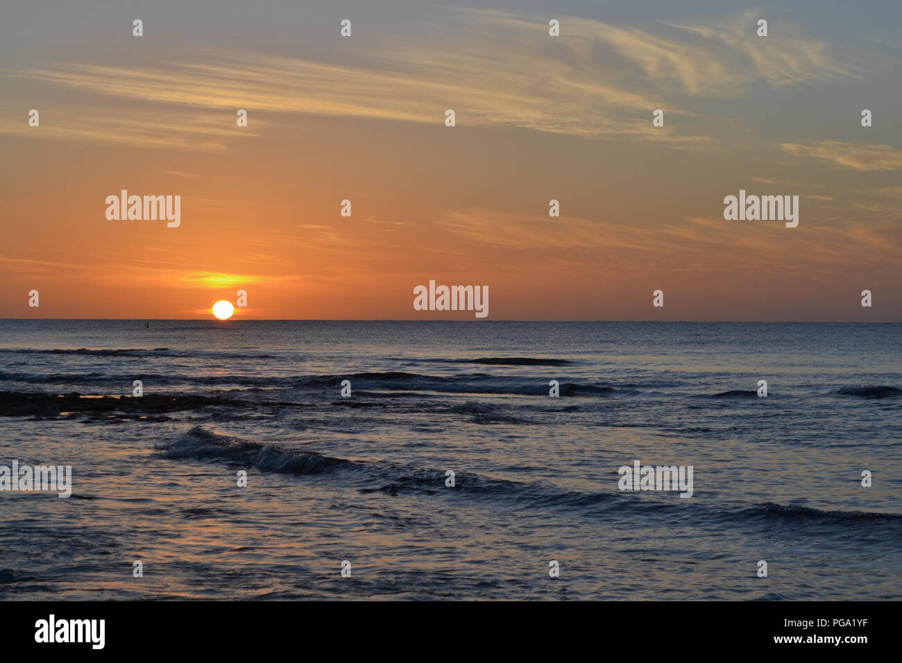 Sunset off of Seven Mile Beach in Grand Cayman - Stock Image