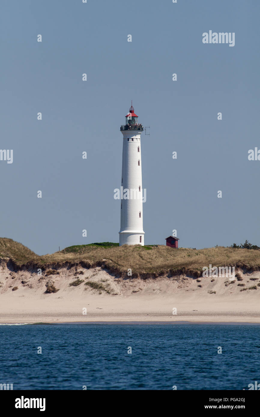 People standing on top of Lyngvig Lighthouse (Lyngvig Fyr) on the west coast of Jutland coast in Denmark. The lighthouse was built in 1906 and was the last built along this coast. Although no longer used for maritime navigation, it was built following a tragic accident at sea in 1903, where 24 sailors lost their lives. The light was lit for the first time on 3rd November 1906. - Stock Image