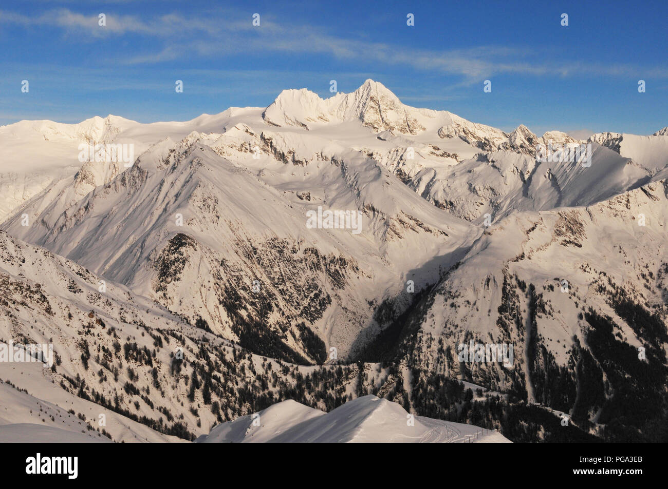 Panoramic mountain view of the Grossglockner Snow mountain range in East Tyrol from the Adler Lounge above Matrei Stock Photo