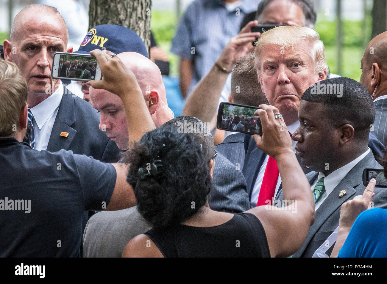 New York, USA, 11 September 2016. US President Donald Trump (candidate at the time) is surrounded by bodyguards as bystanders attempt to snap photos o Stock Photo