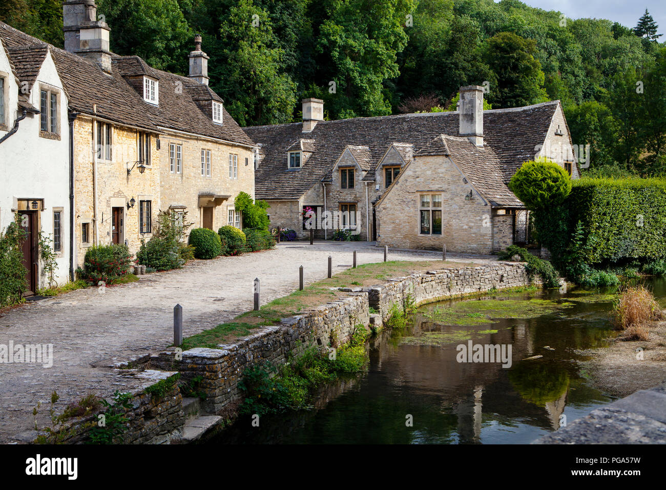 Castle Combe, UK - 9th August 2018: Castle Combe is a quintessentially English village often named as the 'prettiest village in England.' Stock Photo