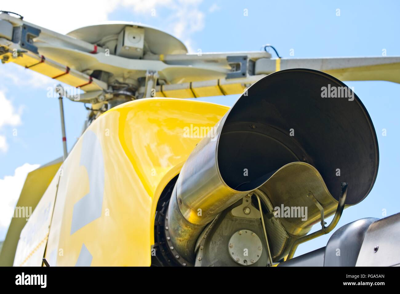 Yellow helicopter close up on the rotors. Air Vehicle, Built Structure, Gold, Helicopter, Manufactured Object - Stock Image