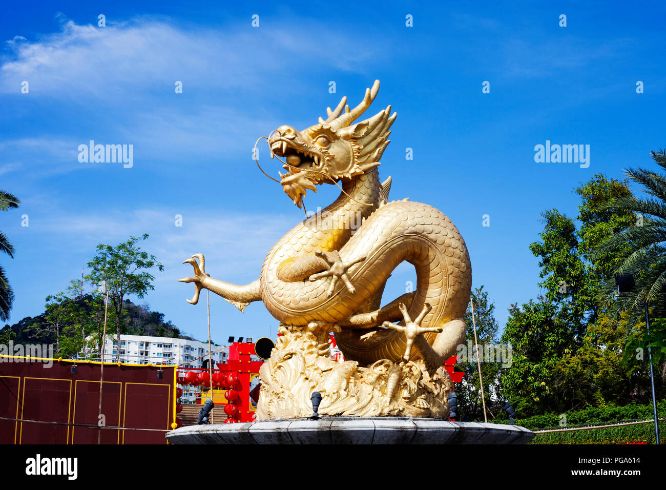Fountain with gold Dragon in Phuket Town, Thailand  Golden chinese