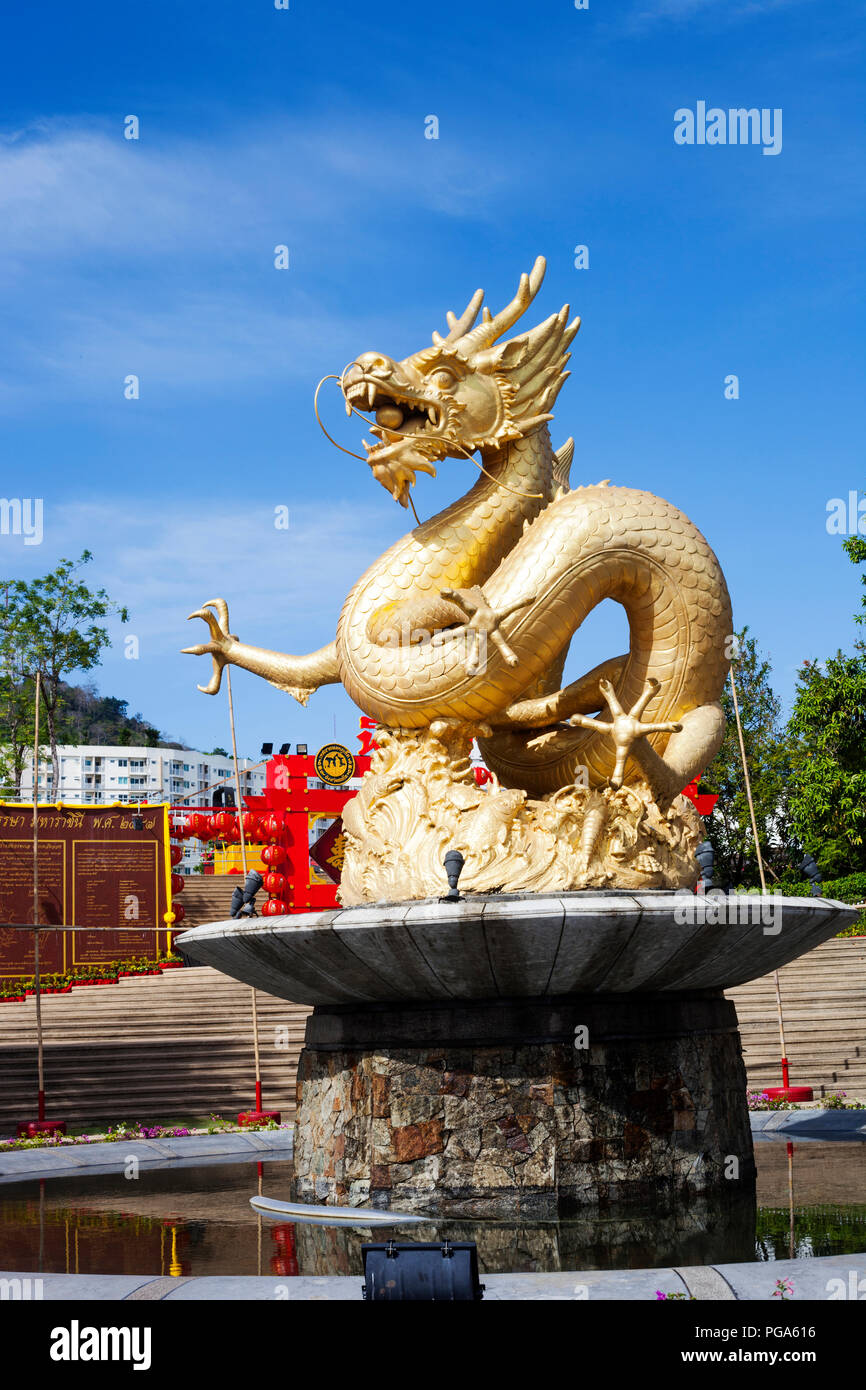 Phuket, Thailand - 20 February 2018: Fountain with gold Dragon in