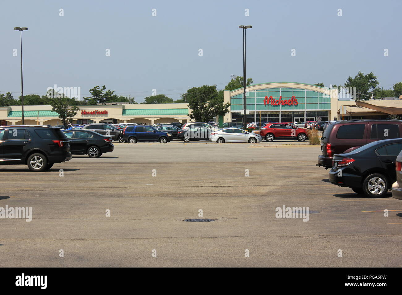 Standard strip mall shopping center in suburban Niles, Illinois, USA on a summer day. - Stock Image