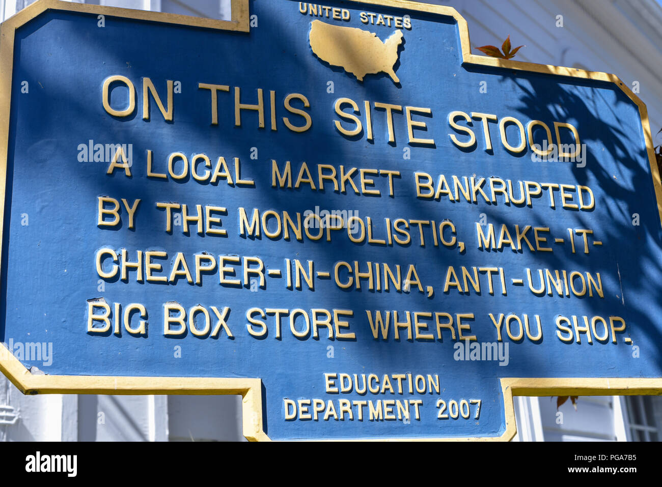 Alternative sign bemoaning the loss of a local market, Woodstock, New York, USA - Stock Image