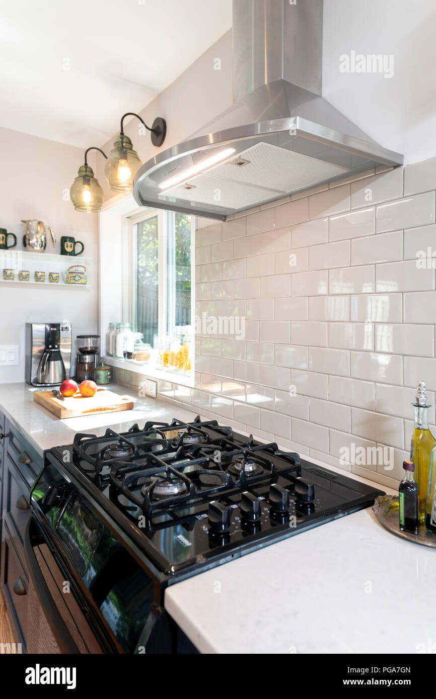 - A Gas Stove In A Modern Home Kitchen With An Electric Ventilation