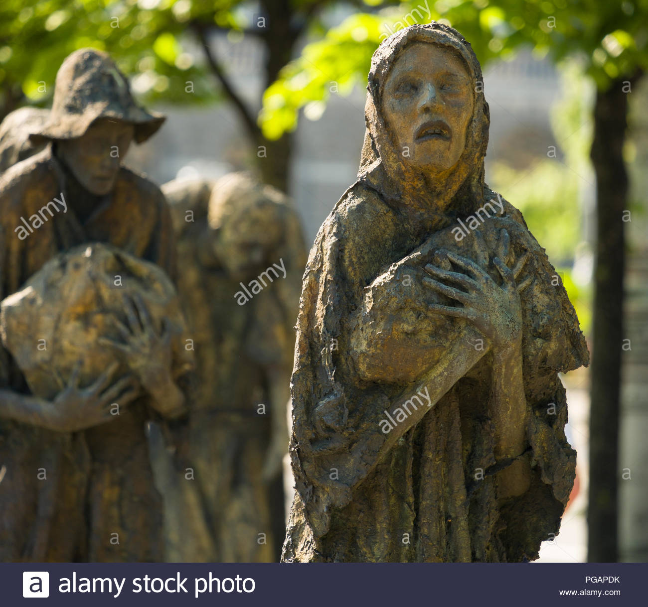 Haunting statues at the Famine Memorial by Rowan Gillespie, Custom House Quay, North Dock, Dublin, Leinster, Ireland - Stock Image