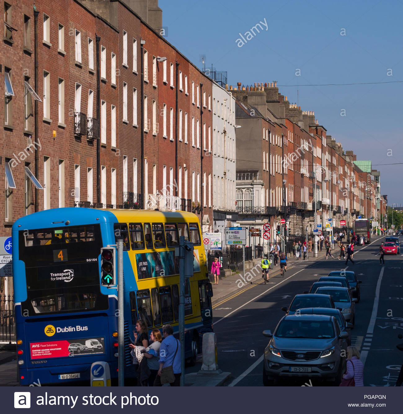 Motor coaches and automobile traffic on Clare Street, Dublin, Leinster, Ireland - Stock Image