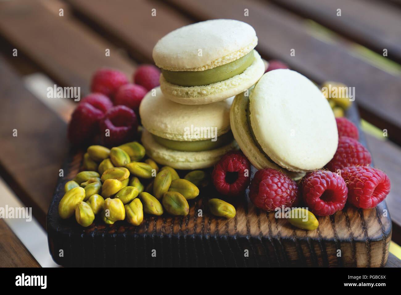 french macaron and pistachio on white background - Stock Image