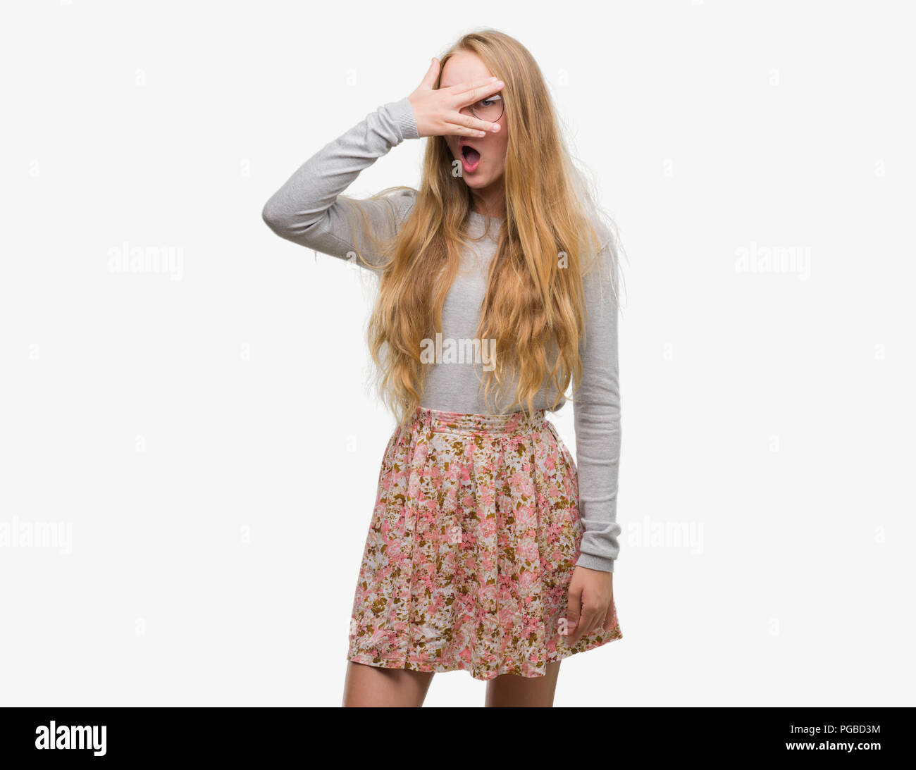 Embarrassed blonde teen
