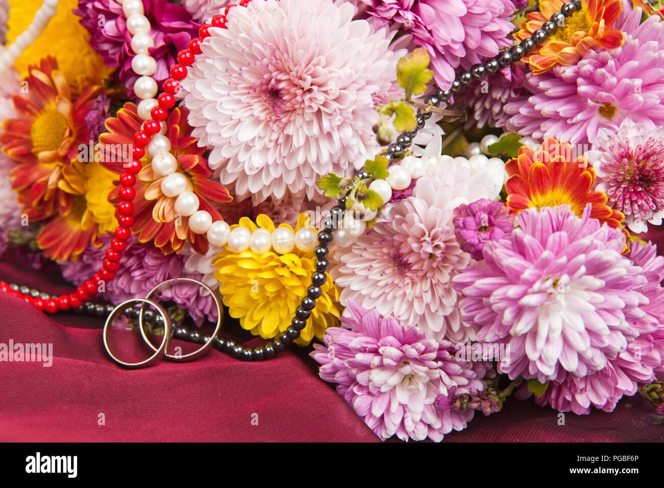 Wedding Rings Flowers On Fabric Stock Photos & Wedding Rings Flowers ...