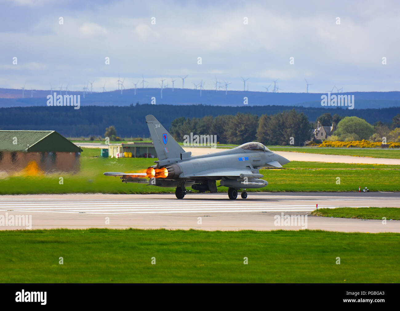 An RAF Lossiemouth Eurofighter FRG4 on a QRA take off with glowing afterburner tail pipes. - Stock Image