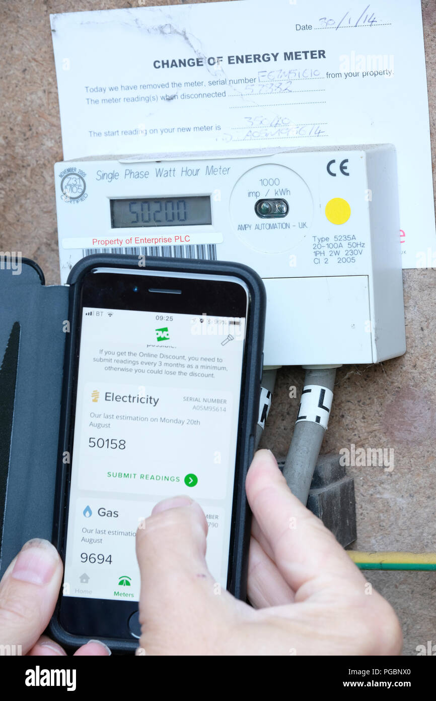 Submitting gas and electric meter reading to energy company using an App on a smart phone - Stock Image