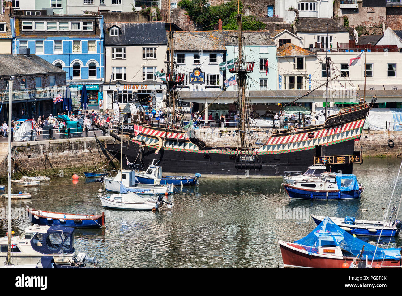 23 May 2018: Brixham, Devon, UK - The harbour with the replica Golden Hind on a fine spring day. Stock Photo