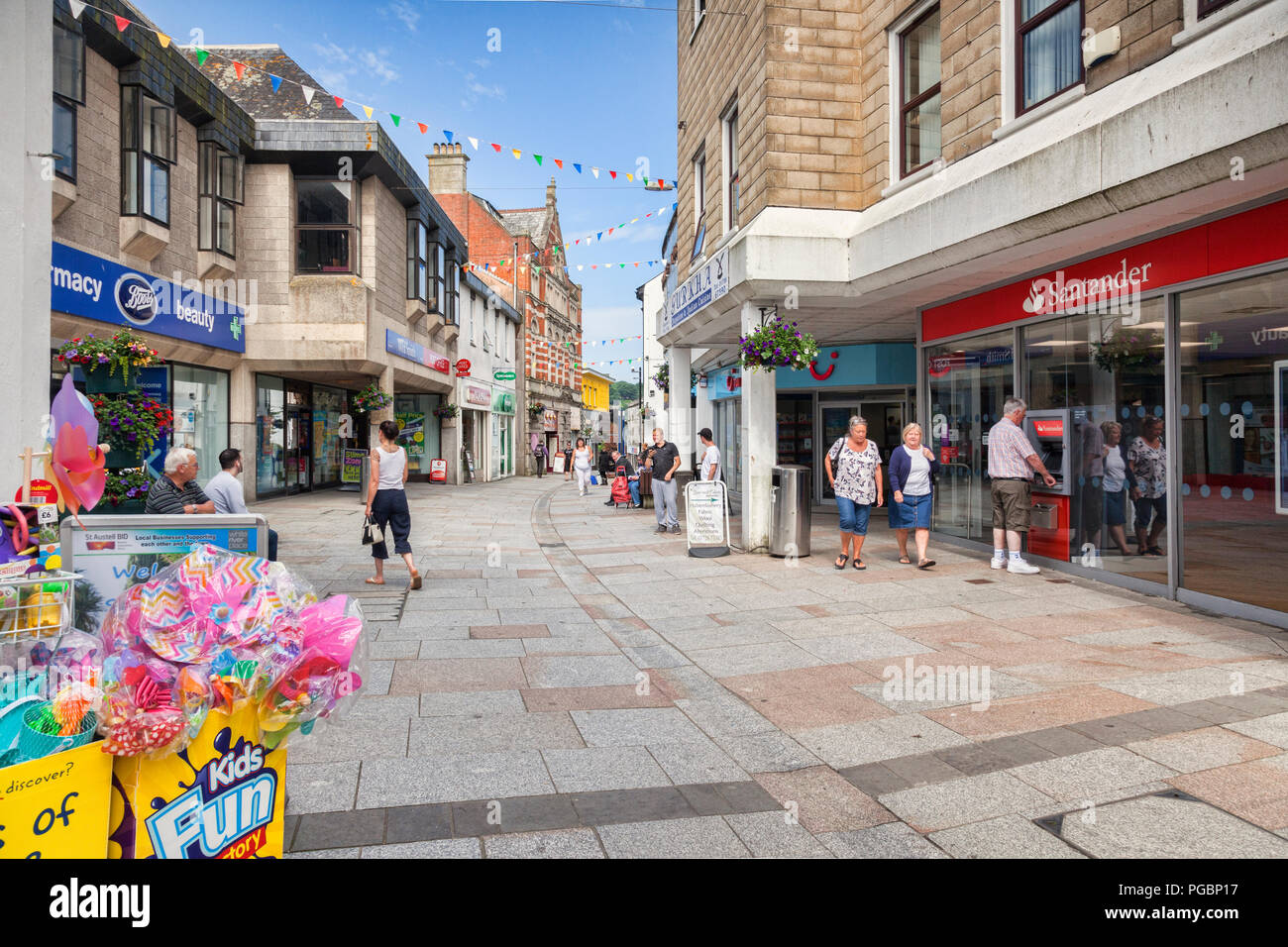 11 June 2018: St Austell, Cornwall, UK - Shopping in Fore Street. - Stock Image