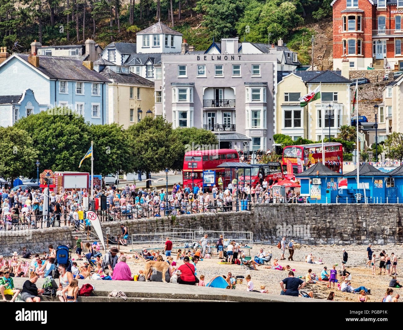 25 July 2018: Llandudno, Conwy, UK - The beach and promenade on a summer day during the July heatwave. - Stock Image