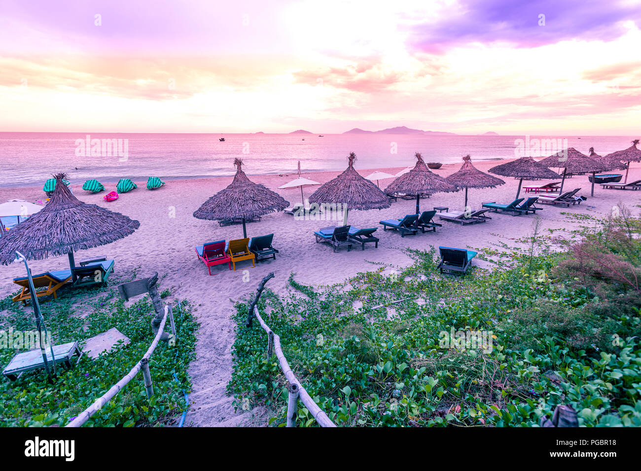 Early morning at a peacful callm sea ath the beach in the South China Sea - Stock Image