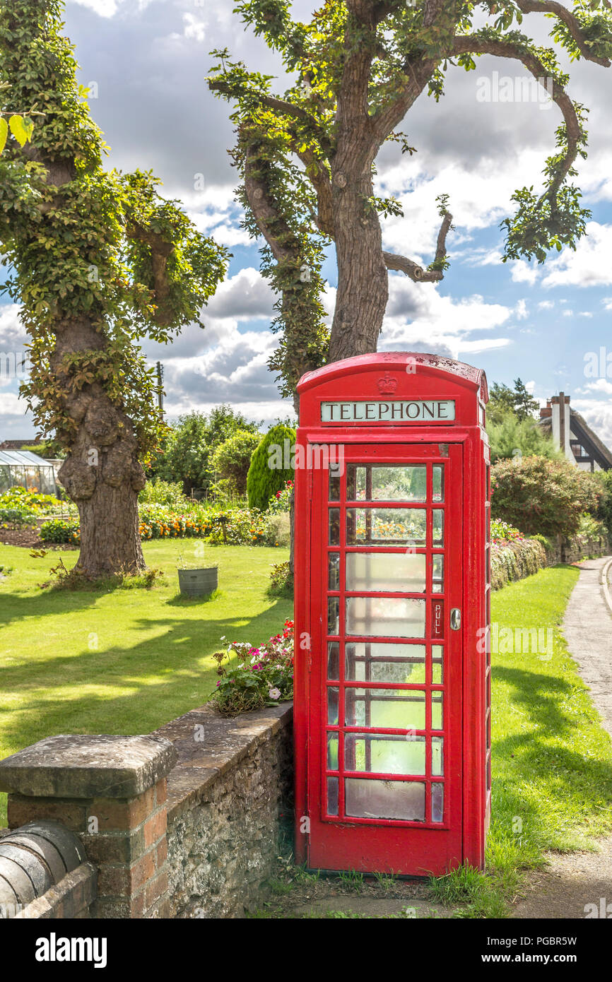 The now vintage English red telephone box, slowly but surely disappearing into history. - Stock Image