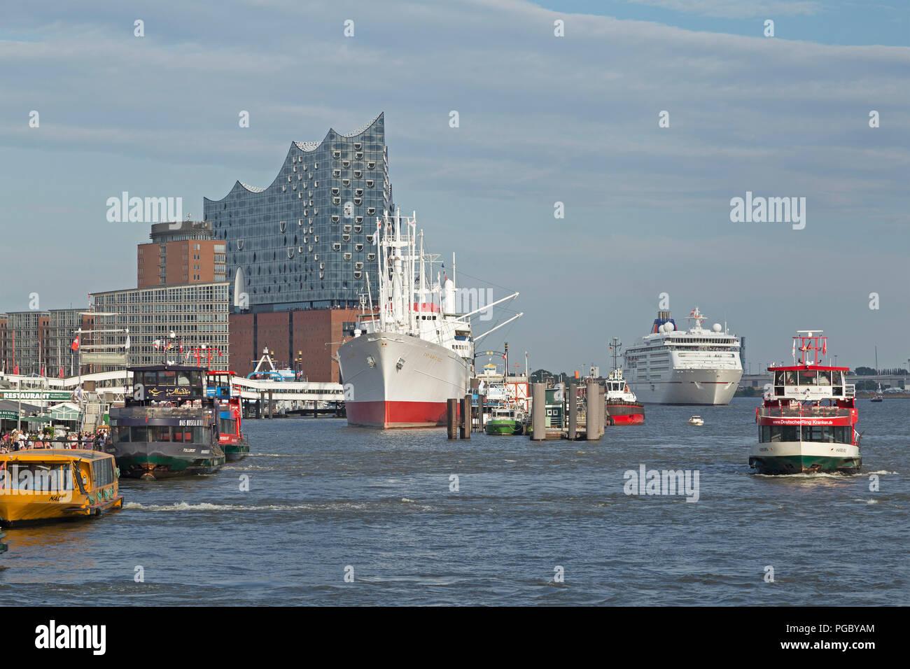 Elbe Philharmonic Hall and St. Pauli Landungsbruecken (jetties), cruise ship Europa 2, Hamburg, Germany - Stock Image