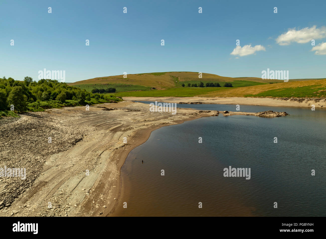 Craig Goch Dam/Reservoir in the Elan Vally, low water level during heatrwave/summer 2018. You could actually walk to the centre of the reservoir. Old  - Stock Image
