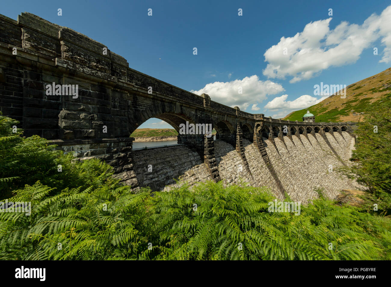 Craig Goch Dam/Reservoir in the Elan Vally, dam arches and walls that normally have water flowing are dry - Stock Image