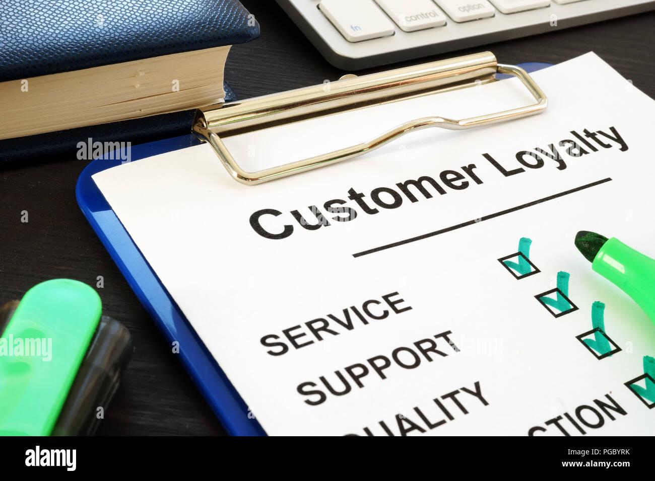 Customer Loyalty program quiz and pen. Service Satisfaction. - Stock Image