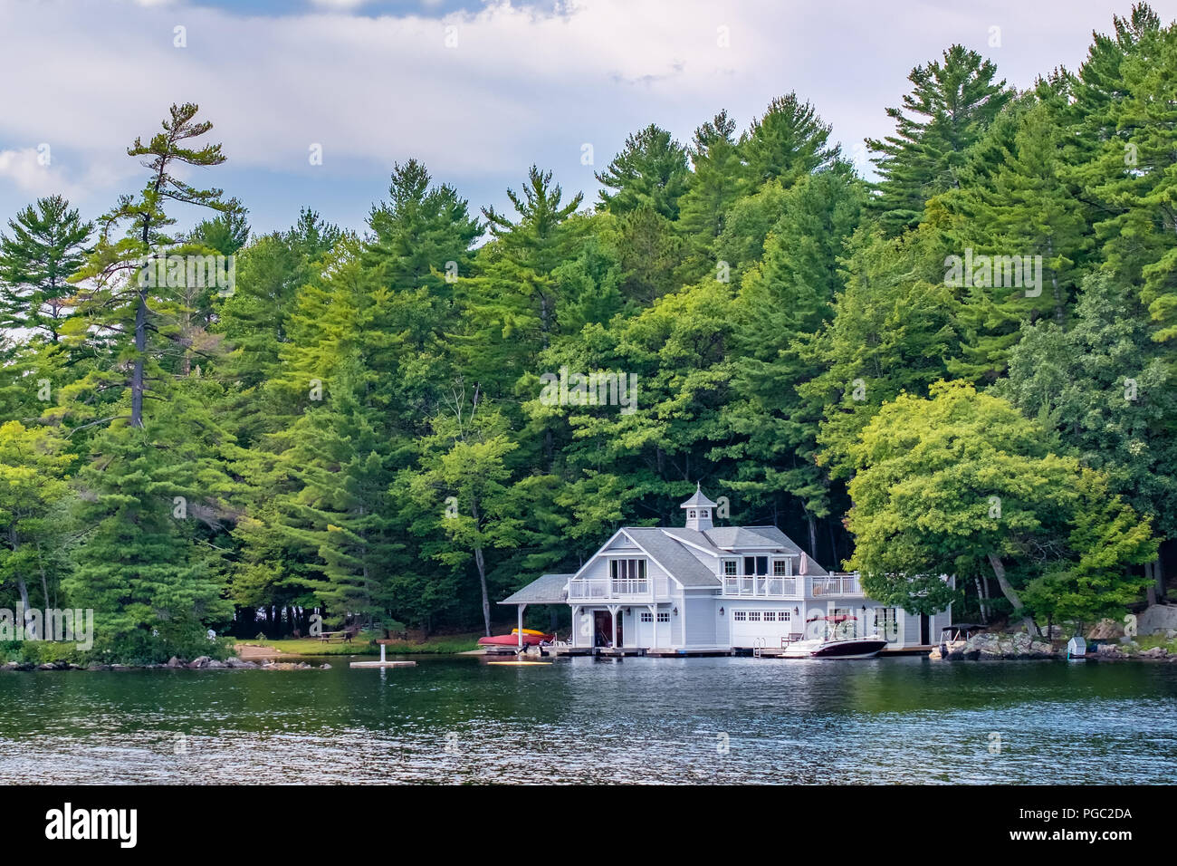 Beautiful boathouse on Lake Muskoka.  This area of Ontario Canada is known a cottage country because of the many summer homes in the region. - Stock Image