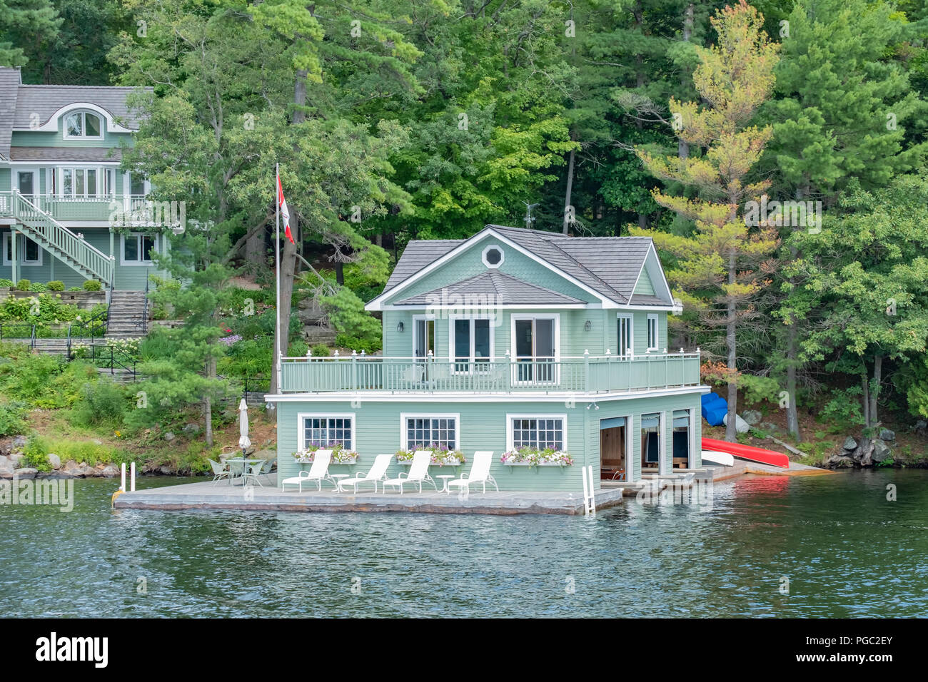 Boathouse on the waters of Lake Muskoka in Ontario Canada, a popular cottage destination. - Stock Image