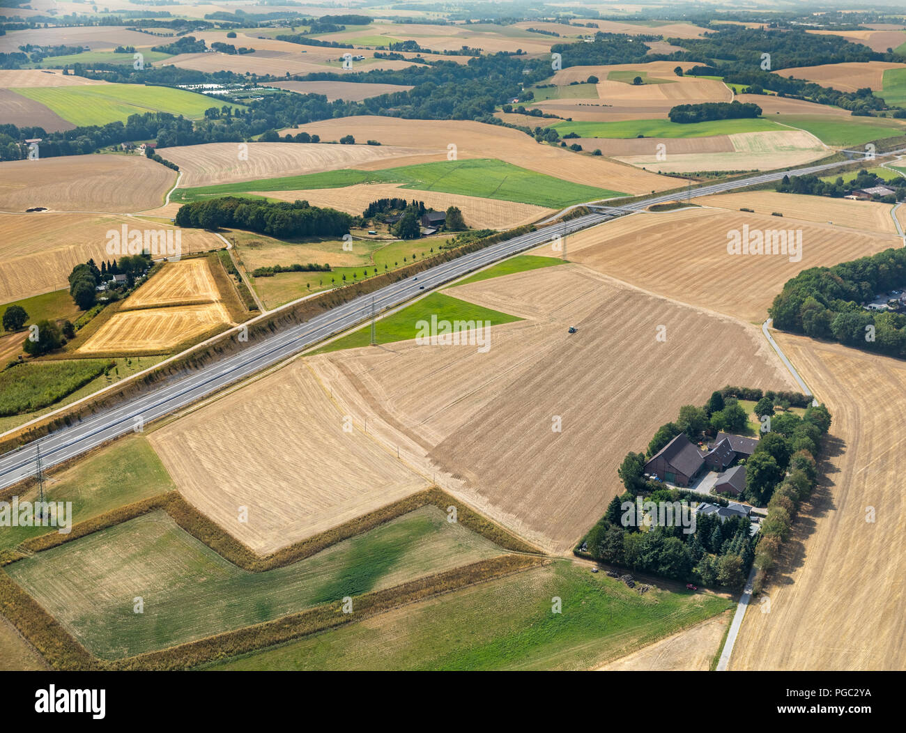 Bare fields, early harvest by drought and dryness next to the highway A44, Hetterscheidt, Holy House, Ruhr Area, Nordrhein-Westfalen, Germany, DEU, Eu - Stock Image