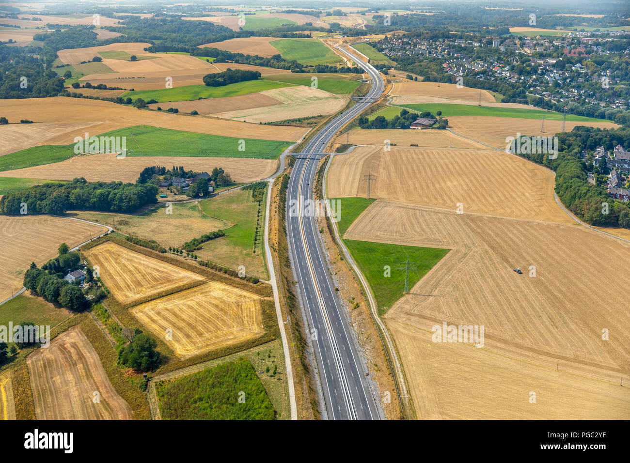 Bare fields, early harvest by drought and dryness next to the highway A44, Hetterscheidt, Holy House, Ruhr Area, Nordrhein-Westfalen, Germany, DEU, Eu Stock Photo
