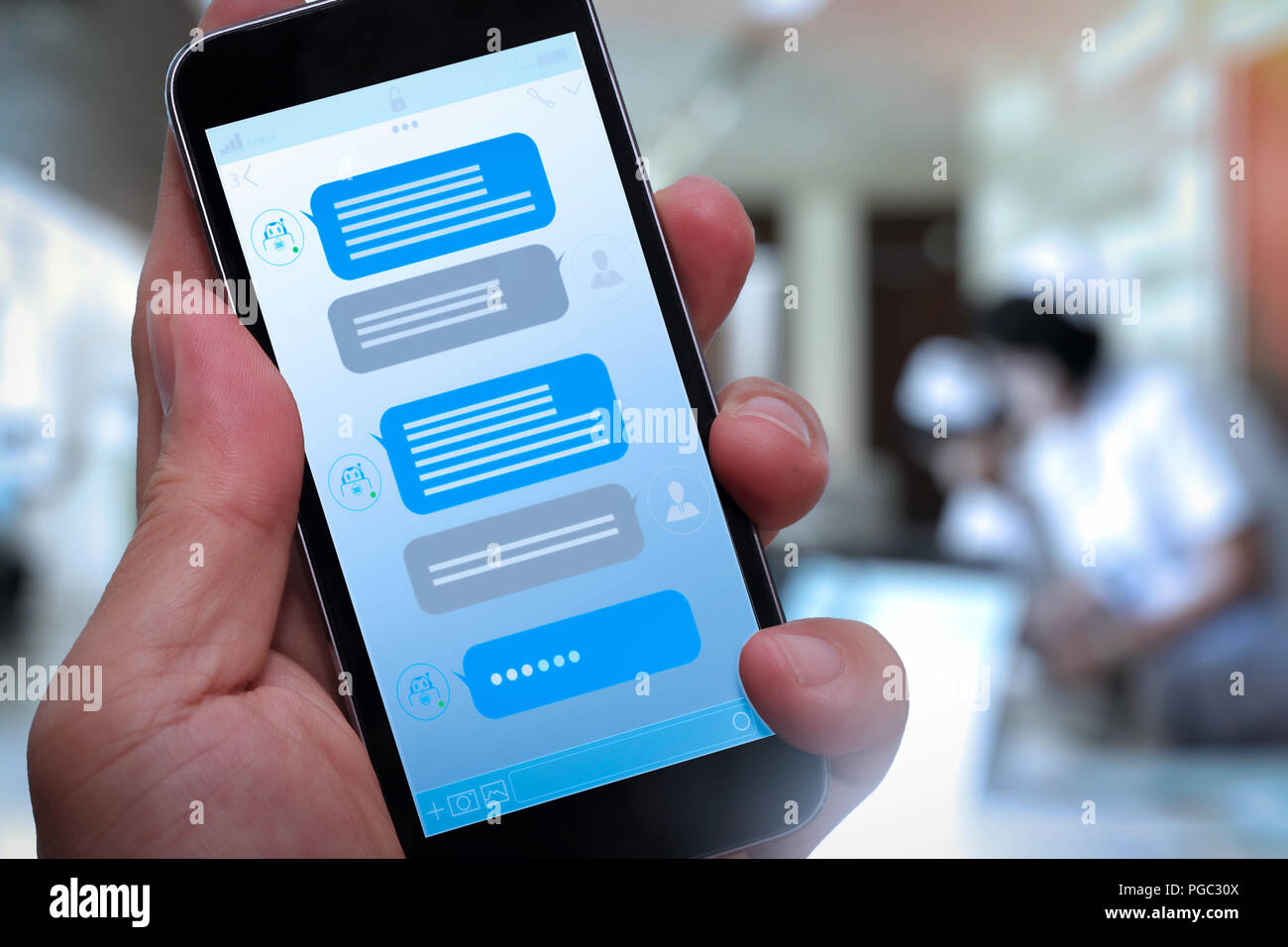 Chatbot conversation with smartphone screen app interface and
