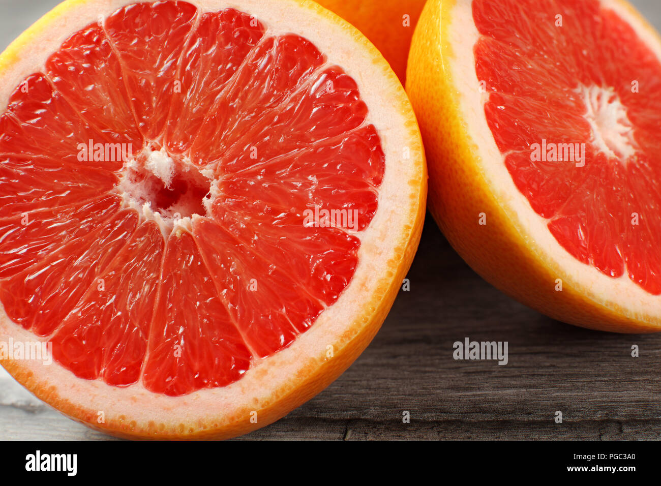 Close up of red grapefruit cut in half - Stock Image