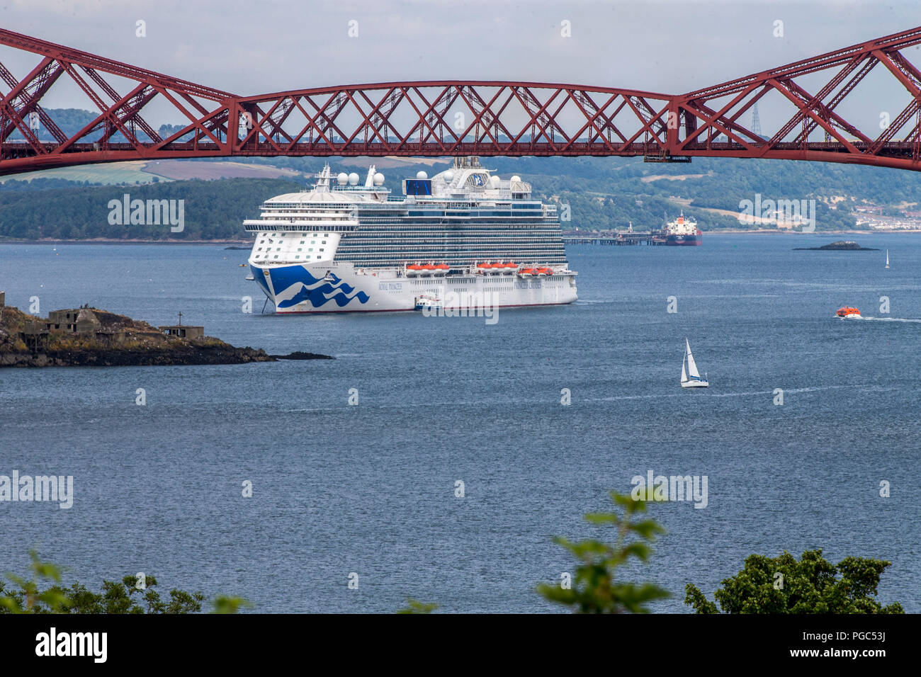 Cruise Ship on river Forth framed by Forth Bridges - Stock Image