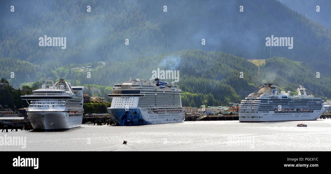 L to R- Cruise ships Golden Princess, Norwegian Bliss and Coral Princess  moored at Ketchikan, Alaska, USA while cruising Alaska's Inside Passage - Stock Image